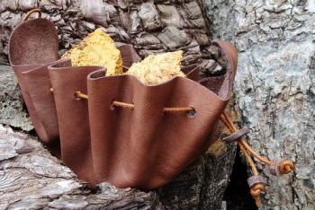 Leather vintage leather merchant pouch made by beaver bushcraft.with tinder