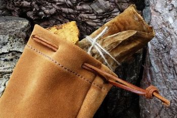 leather tinder pouch in soft caramel suede made by beaver bushcraft for web