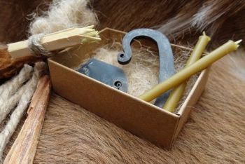 Fire a traditional flint and steel tinderbox made by beaver bushcraft