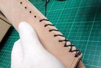 leather mora knife sheath being hand crossed stitch by beaver bushcraft