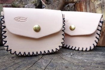 Leather. Hand stitched naural leather possibles pouches made by beaver bush