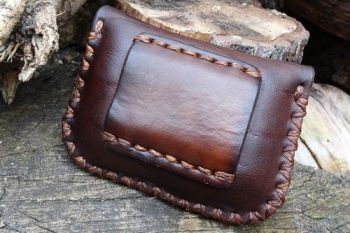 leather. Back veiw of belt pouch made by beaver bushcraft