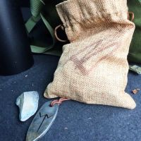 Jim Stilgoe and his beaver bushcraft rune pendant and tinder pouch