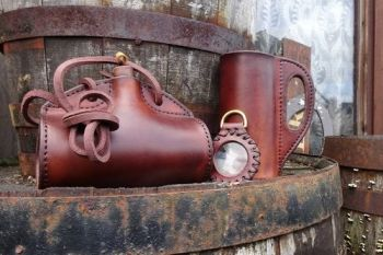 leather handmade bottle with solar lens and leather tankard made by beaver