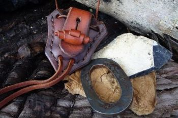leather & fire steel oval pendant by beaver bushcraft