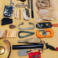 Prepper in the woods fire lighting edc with some items from from beaver bus