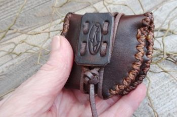 Leather mini tinder pouch folded ,aged, made by beaver bushcraft