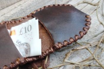 leather folded tinder pouch used as a money folded wallet by beaver bushcra