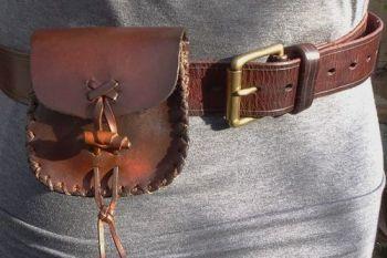 Vintage leather belt pouch worn by beaver bushcraft