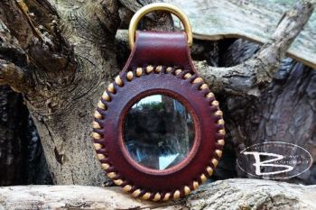 Fire & leather hand stitched solar lens made by the workshop elf for Beaver