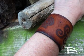 Leather viking style cuff with triskele motif by beaver moon leather