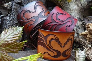 Leather cuffs with celtic dragon motif handmade by beaver bushcraft