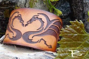 Leather cuff with celtic dragon design hand dyed in saddle tan by beaver bu