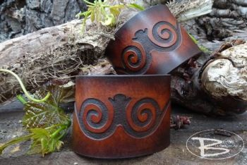 Leather cuffs with celtic scroll design hand dyed by beaver bushcraft