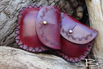 leather coin purses with hand tooled shell motif by beaver bushcraft