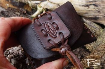 Fire and leather small rustic tinder pouch made by beaver bushcraft