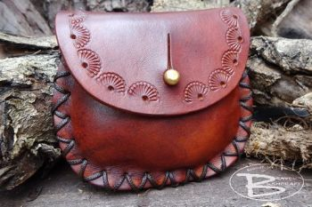 Leather hand tooled shell design pouch made by beaver moon leather