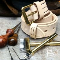 Leather belt bespoke made at beaver bushcraft with tools of the trade