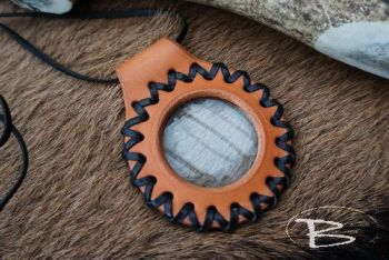 Leather and fire solar contrast pendant by beaver bushcraft