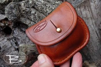 Vintage leather dark saddle tan ombre aged mini belt pouch.held by beaver b