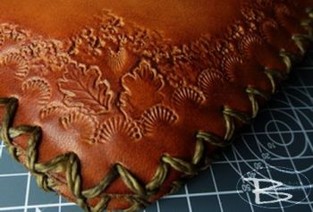 leather example of a beaver bushcraft pioneering pouch that has been hand t