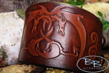 Leather cuff with hand tooled entwined dragons made by beaver bushcraft
