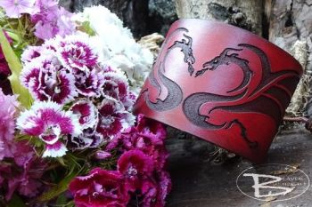 Leather cuff hand dyed in red tones of celtic dragon by beaver bushcraft
