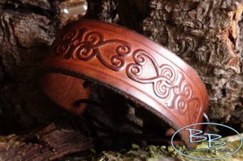 Leather slim hand tooled wrist cuff with celtic heart scroll by beaver bush