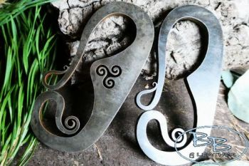 Fire steel designs with curly hooks made by beaver bushcraft