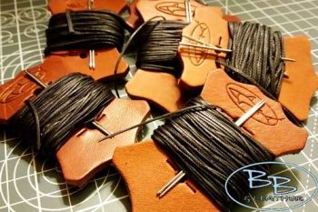 Leather acccessories thread on one of our nice leather tabs with two needle