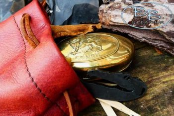 Vintage tinder pouch featuring dragon skin pouch, fire steel and brass drag