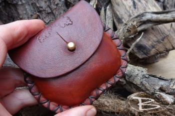 leather mini pocket pouch held by beaver moon
