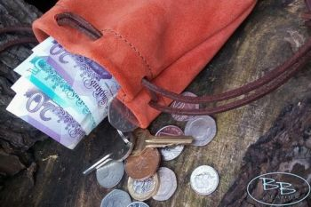 Leather and suede tinder pouch in rich russet by beaver bushcraft
