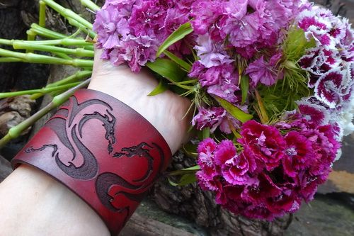Leather cuff in hand dyed mahogany of a celtic dragon by beaver bushcraft