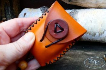 Fire lighting hand sized leather tinderpouch hand stitched by beaver bushcr