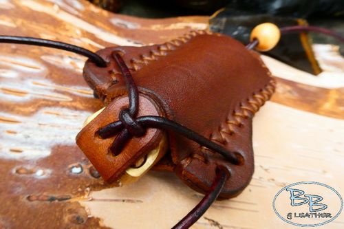 leather stash pot sheath with solid brass pill pot made by beaver bushcraft