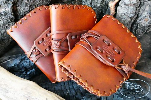 Leather pioneering pouches hand crafted with new style thongng by beaver bushcraft.JPG