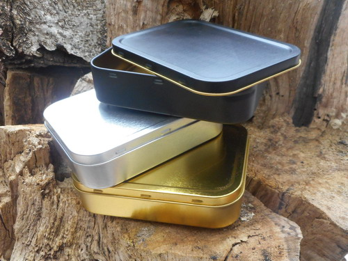 tins-3 together stacked-black-gold-silver