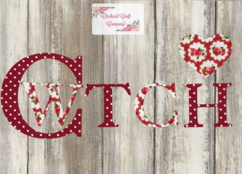 Iron on fabric CWTCH in dotty & floral Fabric