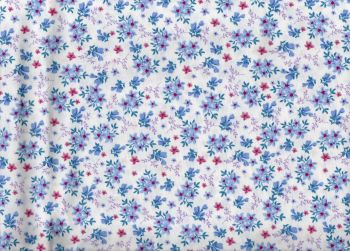 Floral ditsy fabric. White background with violet and pink flowers