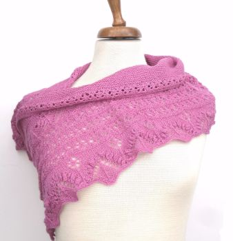Pink hand knitted crescent shaped shawl