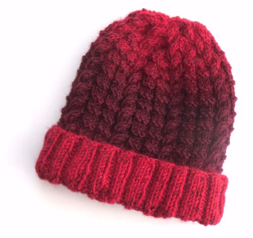 Red knitted beanie hat