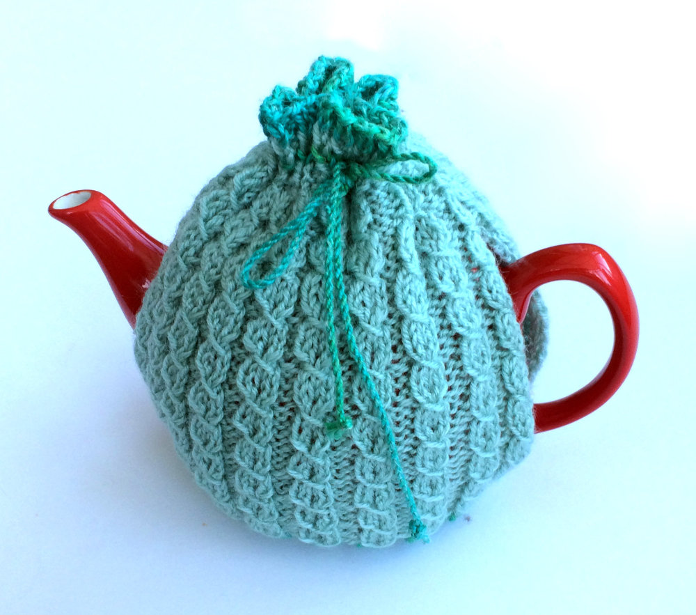 Light blue hand knit tea cosy