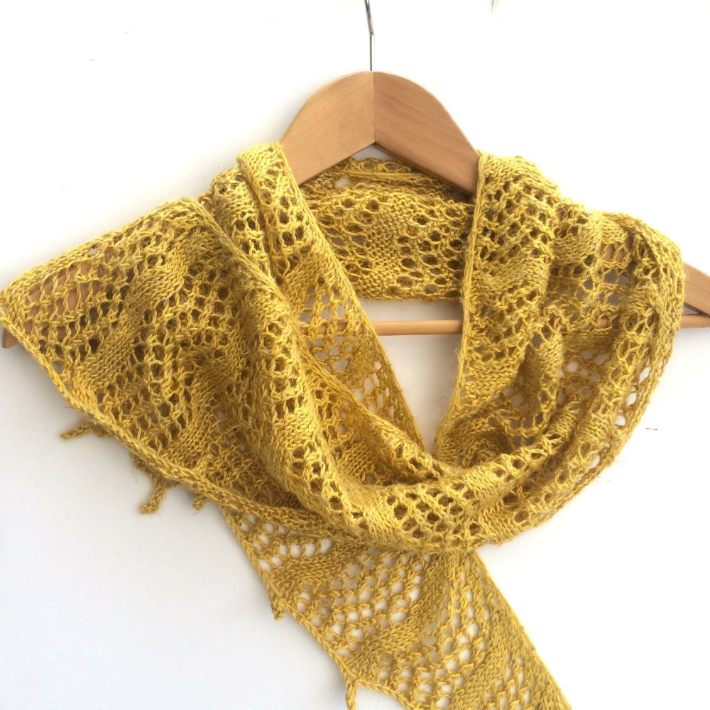 Yellow hand knitted crescent shaped shawl