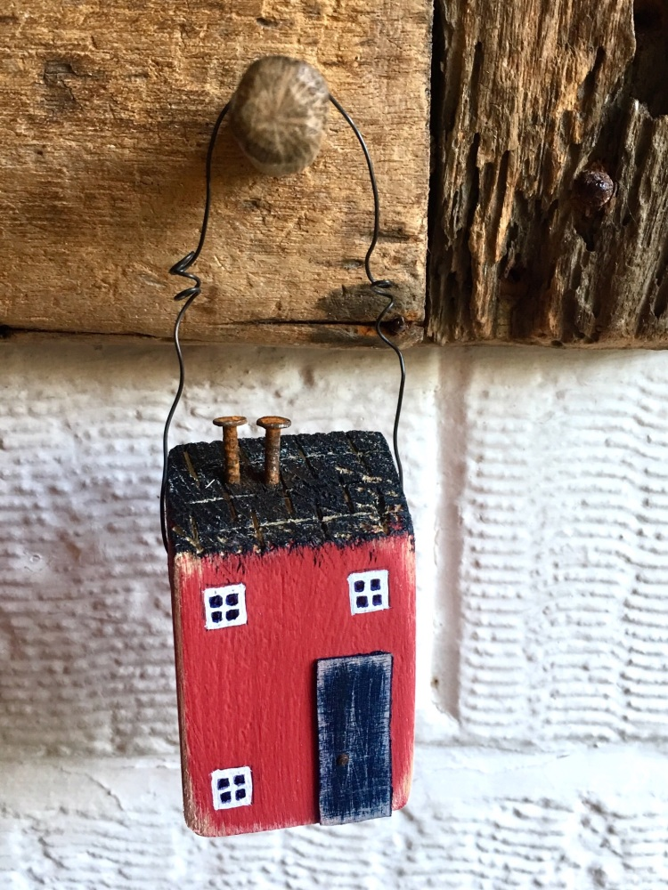 Little red hanging house - navy door