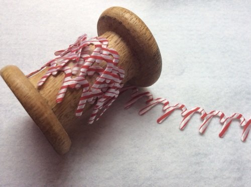 Red and white candy cane satin cut out