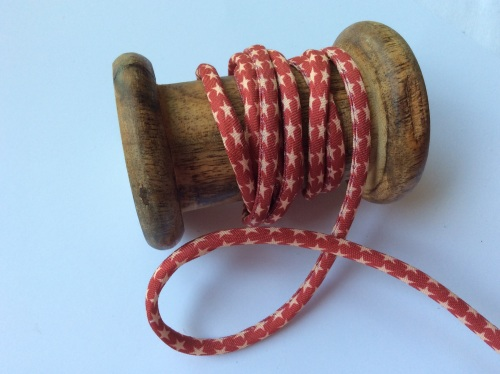 Red star print piped cord