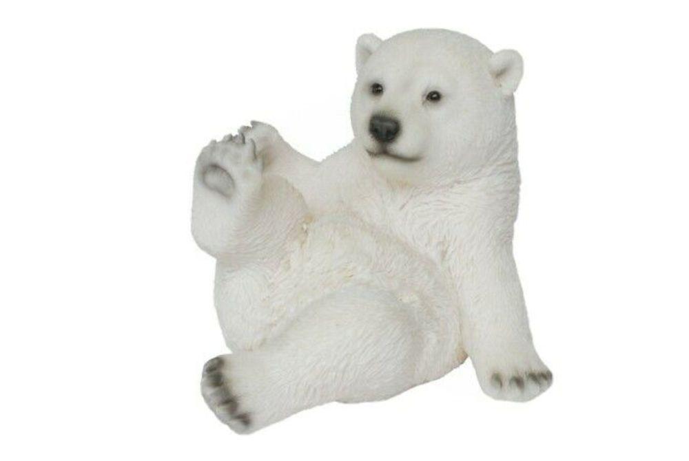 PLAYFUL POLAR BEAR SITTING