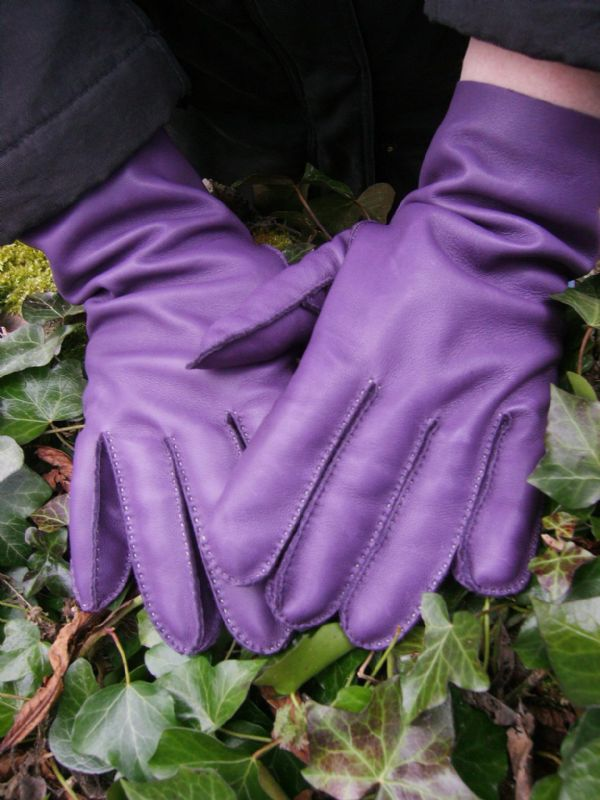 Bespoke gloves. Purple lamb nappa leather that has been hand stitched in lime thread.