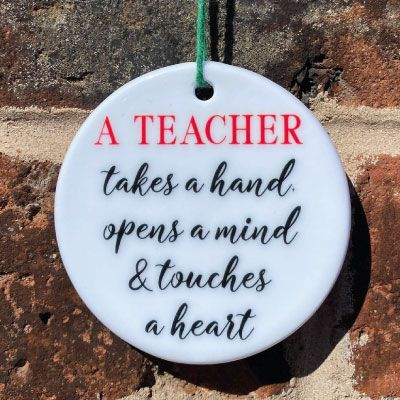 A teacher takes a hand, opens a mind and touches a heart hanging ornament